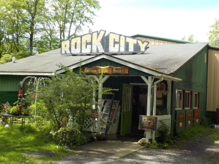 At the end of the road you'll see the parking area and the Rock City Park gift shop!