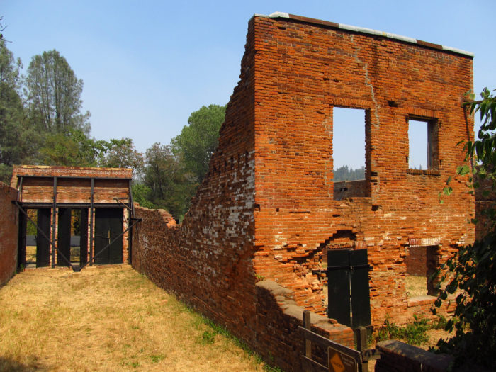 """Six miles west of Redding on Highway 299 a row of old, half-ruined, brick buildings remind passing motorists that Shasta City, the lusty """"Queen City"""" of California's northern mining district, once stood on this site."""