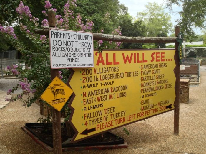 """. . . and a sign declaring """"Wolf Crossing"""" and a list of things you'll see there."""