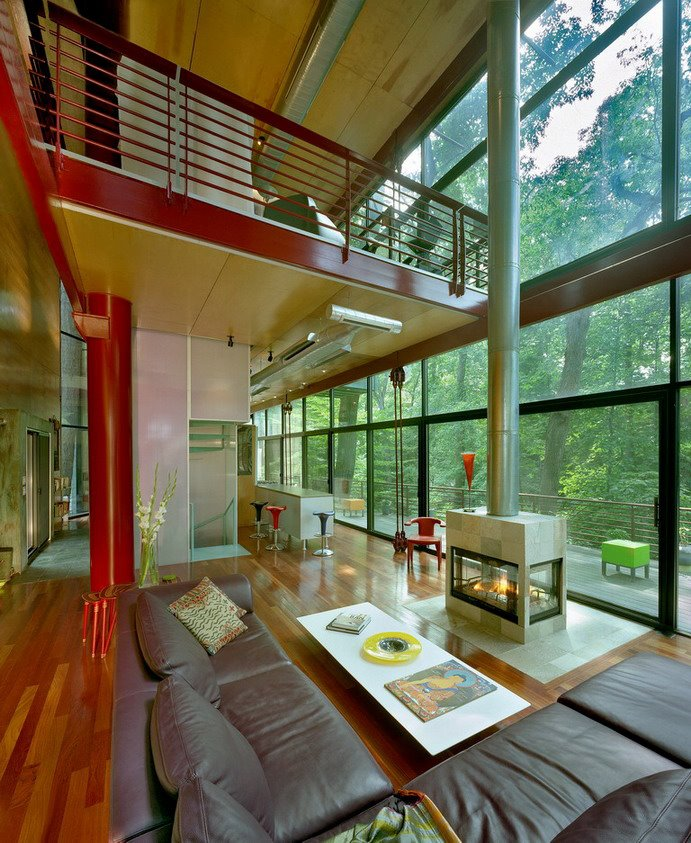 Squeezed among oak and birch trees that frame the house, a wall of glass stretches across one side of the home, making you feel as if you are actually living right in the forest, as opposed to living in a home in the forest.