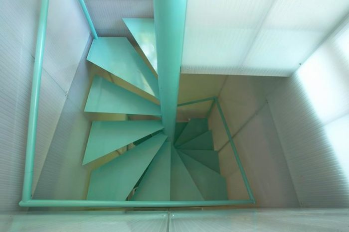 """A narrow geometric staircase takes you upstairs to the second and third floor. The fourth floor is known as the """"birds nest"""" and has an outdoor terrace."""