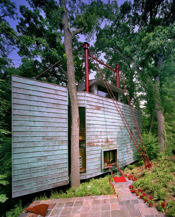 """Travis Price calls his creation """"New York loft meets treehouse"""" and built it because he says he wanted to """"live suspended in those trees"""" surrounding it. It is a beautiful work of art that has been on and off the market since 2007. 2805 Chesterfield Pl NW is currently listed at 3,899,999."""