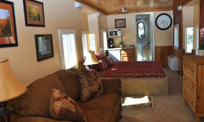 Each caboose is furnished with cozy beds, a sitting area and kitchenette.