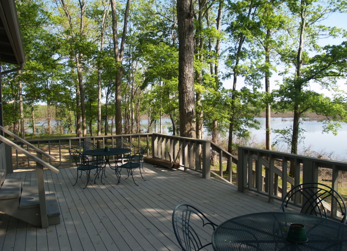 """And includes a spacious deck that offers excellent views of the """"Duck Puddle"""" and the area's wildlife."""