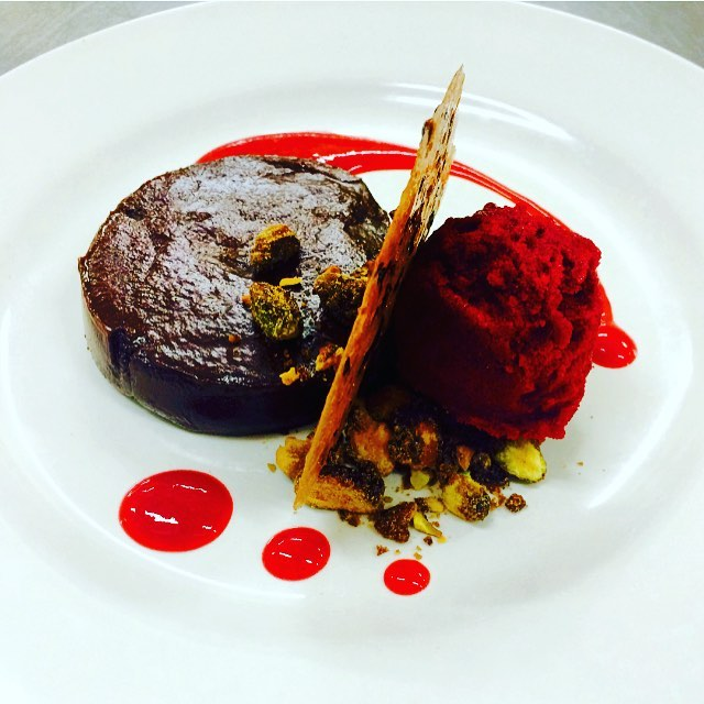 As well as the sweetest dishes - for example, this flourless chocolate cake with raspberry gastrique, mixed berry sorbet, and candied pistachios.