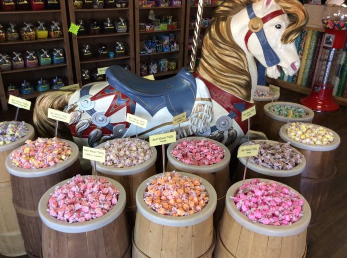 The shop is full of vintage charm, from the walls full of candy and popcorn to the wooden barrels filled with every type of saltwater taffy you can imagine.