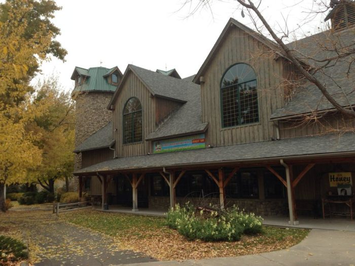 White Fence Farm's Americana Barn is worth a visit all on its own and is chocked full of shops, snacks, and entertainment.