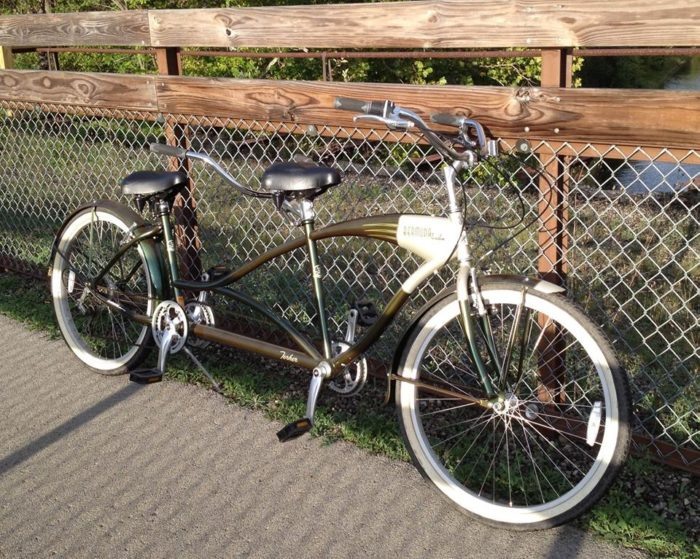 Rent a tandem bike (or a traditional bike) for a ride around town and along the river or...