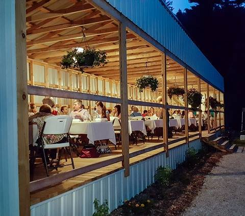 The dinner takes place on a covered deck.