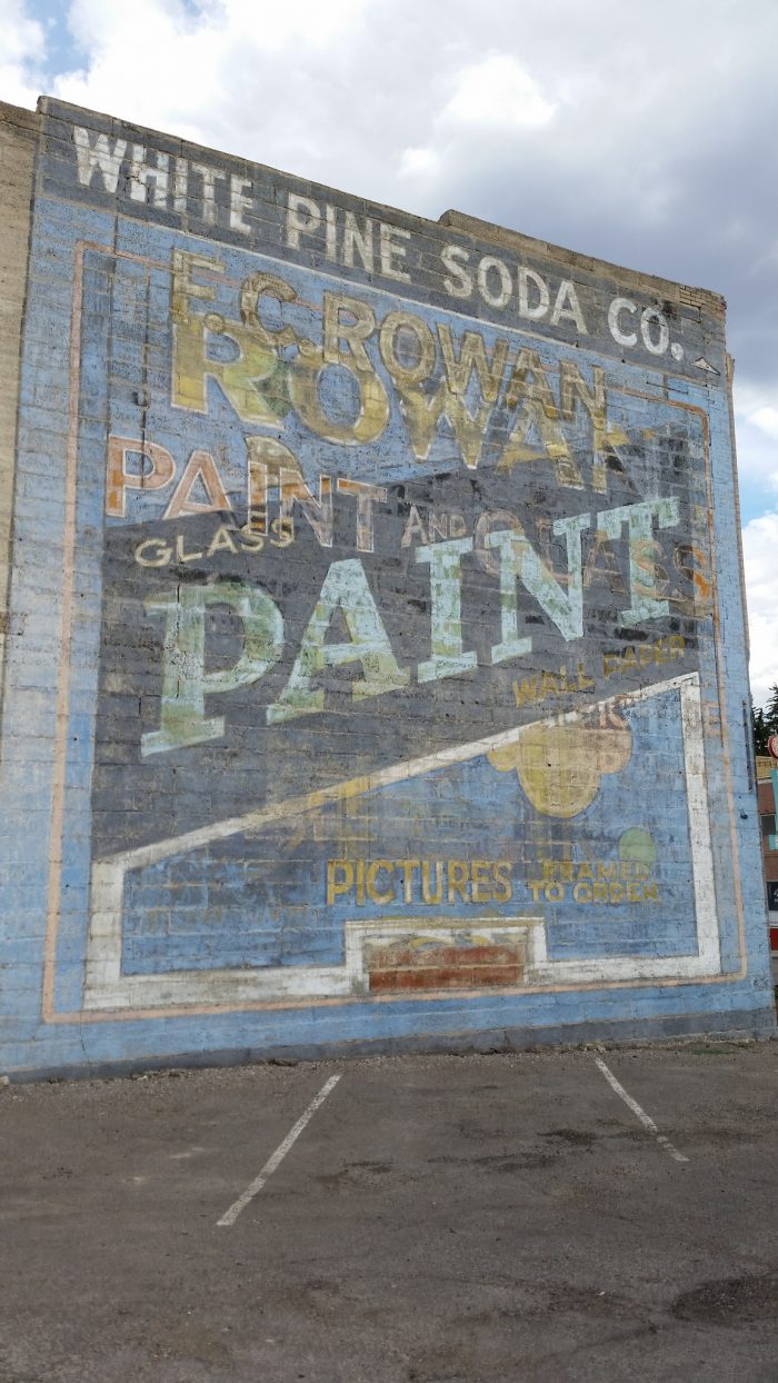 Take a stroll through town to see this ghost sign, and the many newer murals painted on the sides of the buildings.