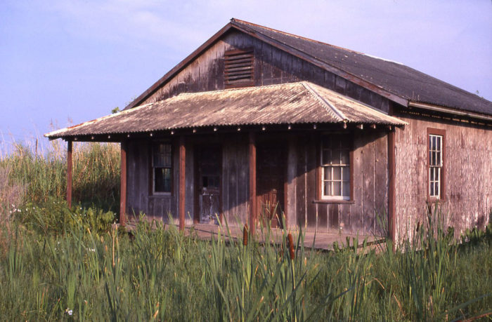 Before Hurricane Katrina, many structures from the original town, like this home, were still standing.