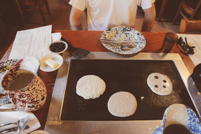 This naturally led to a bakery and restaurant utilizing the fresh-ground flours, but with a unique twist. Tables were fitted with electric griddles in the middle, so guests can pour and flip their own pancakes.