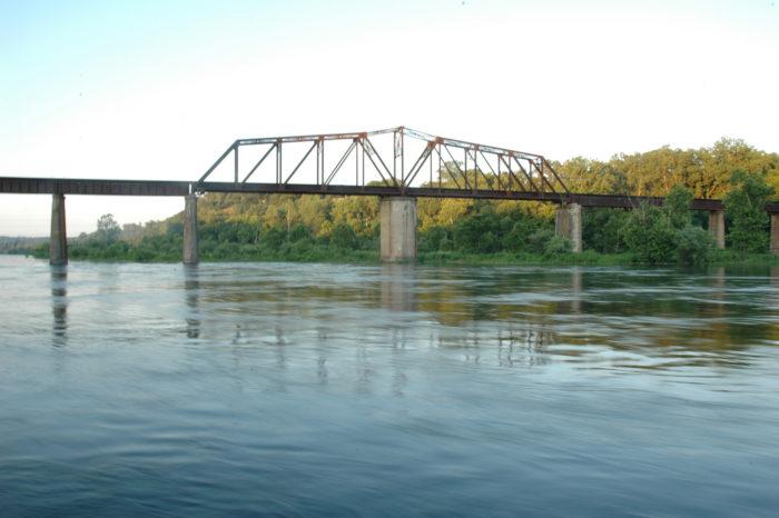 A train bridge runs parallel to the Cotter Bridge.