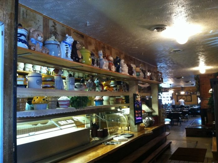 The colorful containers line the walls, sitting on shelves and surrounding diners as they eat.