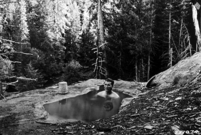 Here's an awesome photo of  a forest ranger soaking in the hot spring back in 1930.