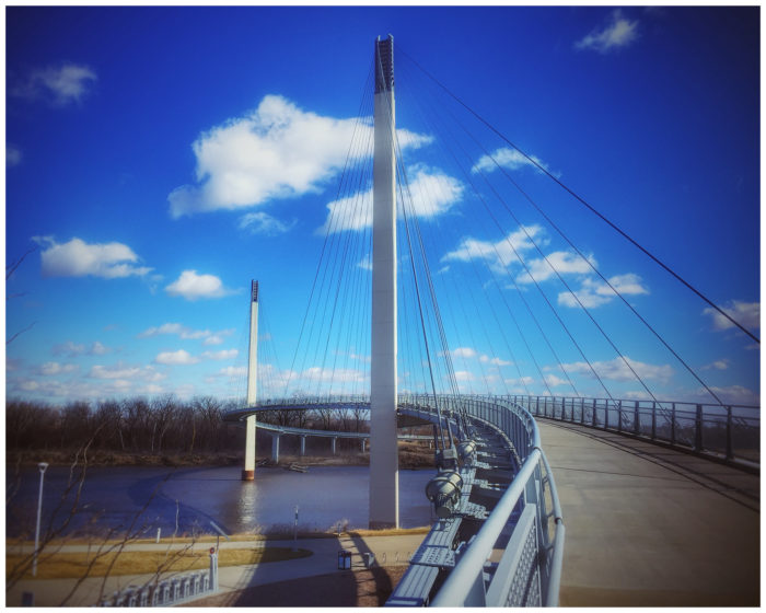 The 3,000-foot-long, 15-foot-wide walkway connects Miller's Landing in Omaha to the Iowa Riverfront Trail in Council Bluffs. Extensive walking paths continue out from the bridge on both sides, so you can walk uninterrupted for miles and miles.