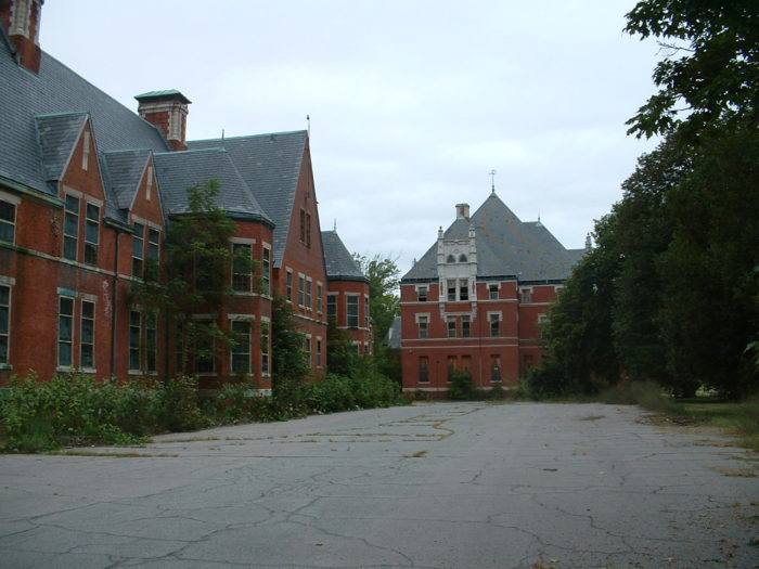 Located in Preston, the Norwich State Hospital sits near the scenic Thames River. Underground tunnels connected all of the buildings together, but are now full of cancer causing asbestos.