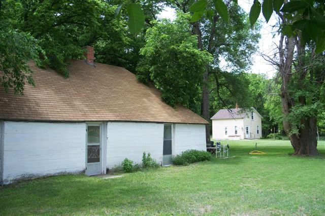 Here, the property's historic sod house sits, looking inviting.