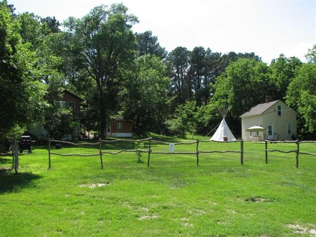 There's even a little teepee next to the small cabin. It's just the right size for kids to play in.