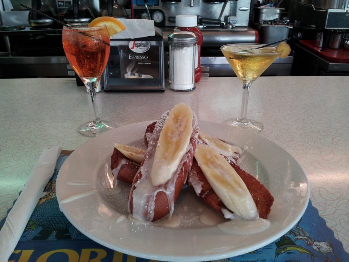 This is a happening city, so the diner is open 24 hours a day, Thursday through Saturday (and until midnight every other day) and has a full bar. Pictured is Grand Marnier Bananas French Toast and two cocktails, the Tropical Daiquiri and the Aperol Spritz.