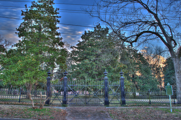 Airliewood is located on Salem Avenue in Holly Springs. Surrounded by iron fences and mature trees, the home is almost entirely hidden from street view.