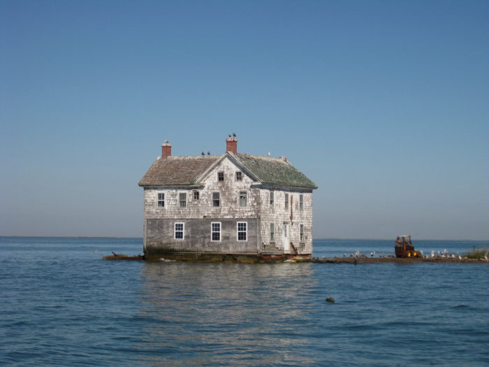 Previously, we wrote about Holland Island, a portion of which now rests in a watery grave in the Chesapeake Bay. Here is the famous Holland Island house that stood strong for many years, despite rapid erosion.