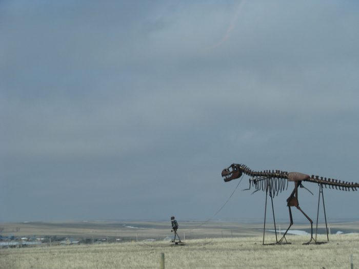 3. The boy walking a dinosaur sculpture, which turns a lot of heads when people first see it.