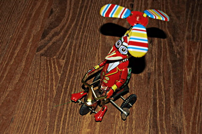 You'll find whimsical toys made of wood and tin.