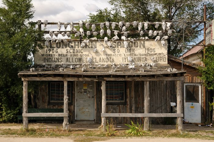 Some buildings still stand in Scenic, including this creepy Longhorn Saloon.