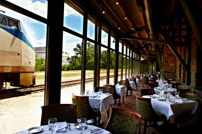 You'll feel as though you've been transported to a different world — one where elegance reigns supreme as you watch trains roll by just outside the window.