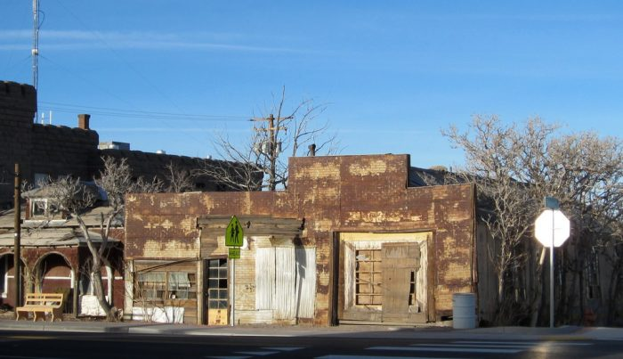 Shuttered buildings sit, decaying.