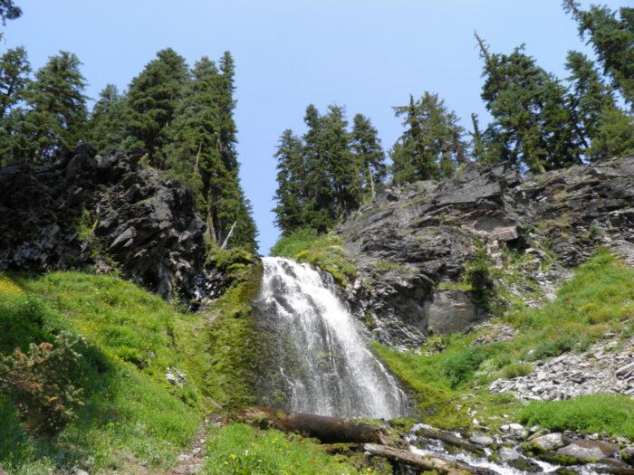 The waterfall's simple elegance is mesmerizing.