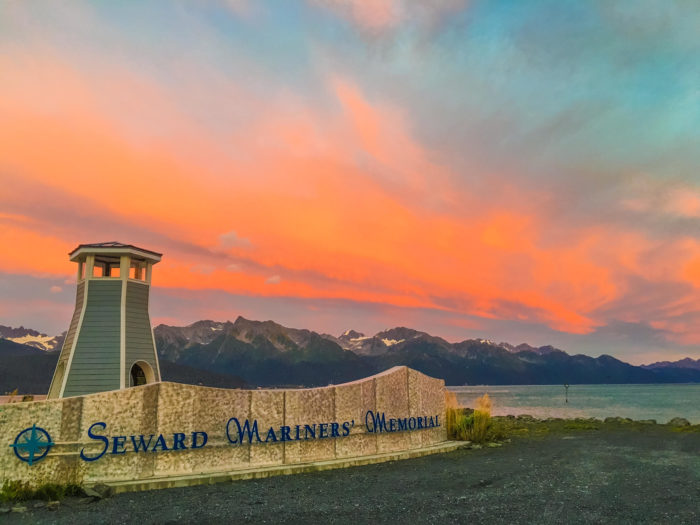 If you time it just right, you might end up catching a stunning sunset over the lighthouse at the Seward Mariners' Memorial.