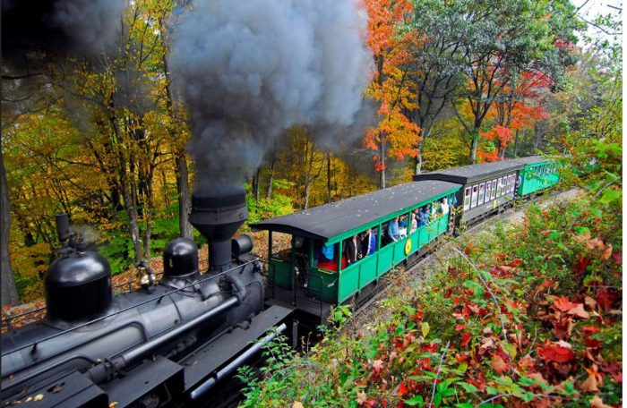 These passenger cars are open air, letting you experience the fall air and the smokey train engine.