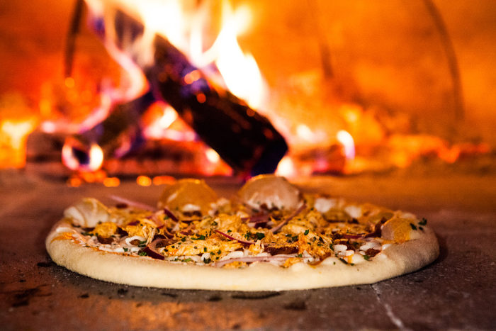 The temperature reaches 700 degrees, so the pizza bakes for only a couple of minutes before it is perfectly cooked.