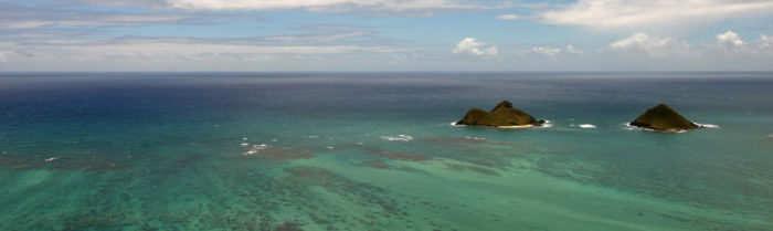 The larger of the two islands - on the left when photographed from Lanikai - is Moku Nui, and the smaller is Moku Iki.