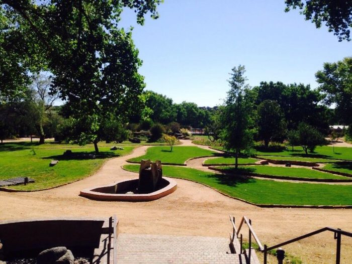As you gaze at the gardens, you're treated to views of the Sangre de Cristo and Ortiz Mountains in the distance.