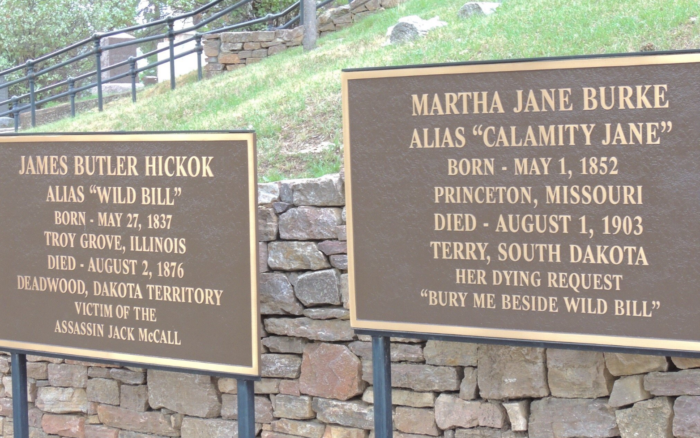 Wild Bill was a well known vigilante, gambler, spy, gunfighter, and lawman, among many things. Calamity Jane was a professional scout and fighter. They rest side by side.