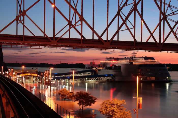On a cool night, dine along the Mississippi River and watch beautiful riverboats pass by.
