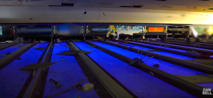 Eerie blacklighting gives the entire place a surreal, menacing ambiance.