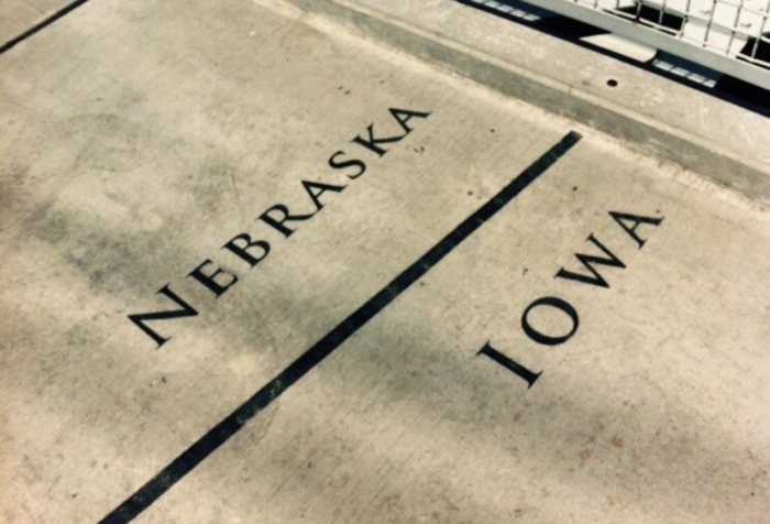 The Nebraska/Iowa state line is officially the middle of the river, so at one point in your walk across the bridge you can stand in both states at once. When walking across the bridge on a weekend, you're almost guaranteed to see people taking pictures of their feet here.