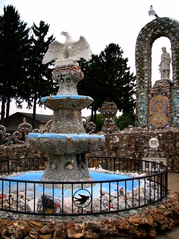It is rather ornate, with a small artificial cave, statue alcoves, arches, and fountains.