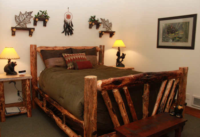 Each room has a beautiful handmade pine bed with designer linens, private baths, and various wildlife themes.