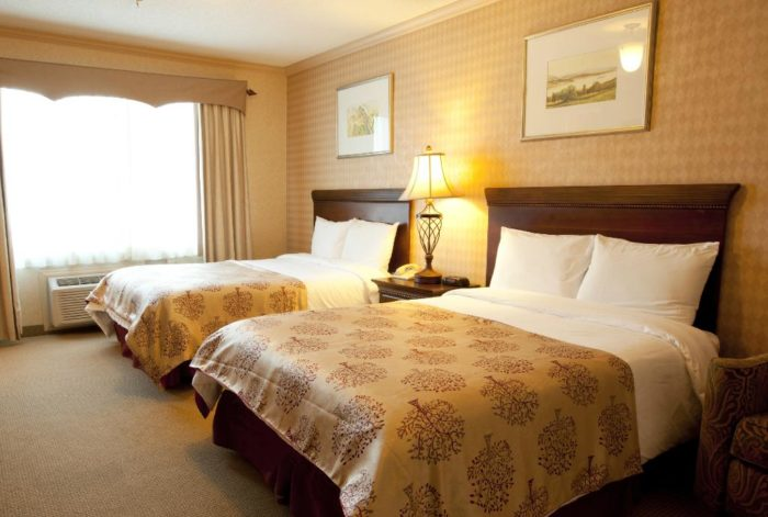 The resort has 232 rooms and suites, with views of the mountains and crystalline lake.