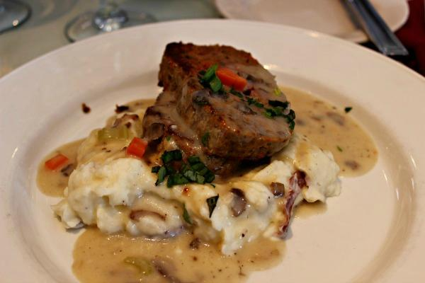 The menu is pretty widespread, with options such as this Meatloaf with Andouille Sausage and Mashed Potatoes...