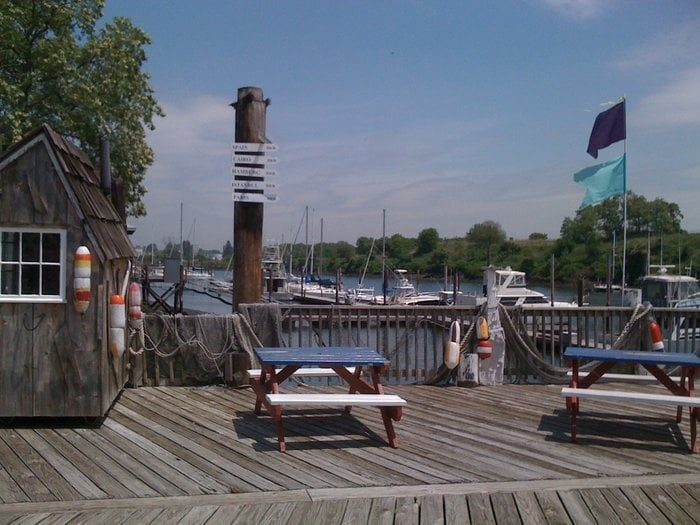 Grab a picnic table at this hidden gem and enjoy the salty air. Or opt for a spot on the upper deck, where you're sure to catch people dancing and enjoying some fun drinks.