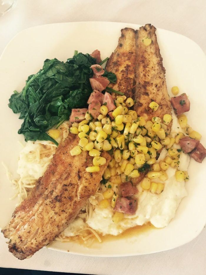 They make favorite Southern classics in the old style, including this redfish with corn and andouille.