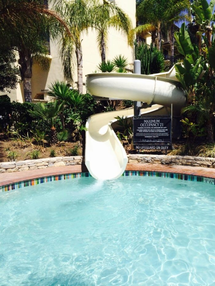 This pool even has a water slide. So if you're a kid at heart, you can still be silly even when you're in paradise.