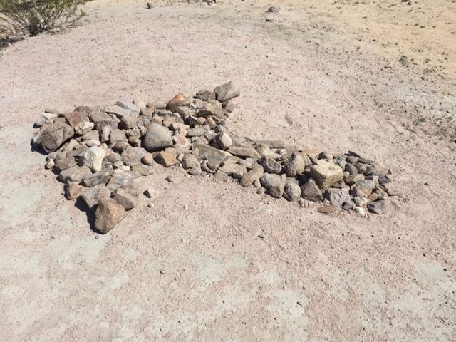Walk about 1/4 mile until you see the rock arrow that points the way to the canyon.
