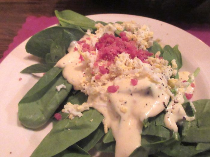 Start your meal with a yummy spinach salad.